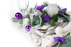 Christmas table setting, in purple tones. Festive Christmas table setting, table decoration in purple tones, with fir branches, Christmas balls on a white royalty free stock photo
