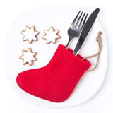 Christmas table setting with red boots and cookies,. On white Royalty Free Stock Photography