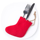 Christmas table setting with red boots,  on white. Close-up Stock Photo