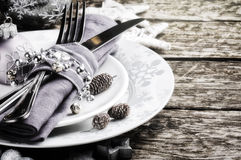 Christmas table setting in silver tone Royalty Free Stock Image