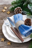 Christmas table setting with spruce branches and stars on wood Stock Photos