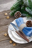 Christmas table setting with spruce branches on wood Stock Image