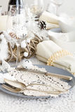 Christmas Table Setting with traditional Holiday Decorations Royalty Free Stock Photo