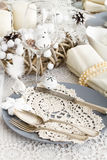 Christmas Table Setting with traditional Holiday Decorations Royalty Free Stock Photos