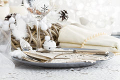 Christmas Table Setting with traditional Holiday Decorations Stock Photo