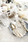Christmas Table Setting with traditional Holiday Decorations Stock Images