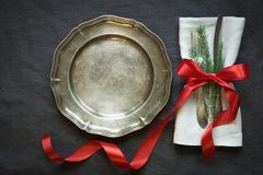 Christmas table setting with vintage dishware, silverware and decorations on gray linen tablecloth. Top view Royalty Free Stock Photography