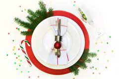 Christmas table setting with vintage dishware, silverware and decorations on gray linen tablecloth. Top view. Xmas royalty free stock photos