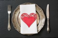 Christmas table setting with vintage dishware, silverware and heart decorations. Royalty Free Stock Photography