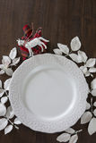 Christmas table setting, white sheets decorated plate on wooden Stock Images