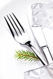 Christmas table setting in white and silver with christmas decor Stock Image
