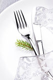 Christmas table setting in white and silver with christmas decor Stock Photography