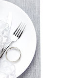 Christmas table setting in white and silver with christmas decor Royalty Free Stock Photos