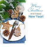 Christmas table setting with wooden decorations over white Royalty Free Stock Photo