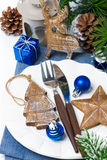 Christmas table setting with wooden decorations Royalty Free Stock Photos