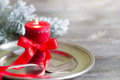 Christmas table with silver ware and red candle Stock Photography