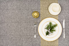 Christmas table top view. Linen tablecloth texture background. Stock Photo