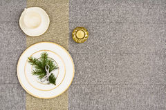 Christmas table top view. Linen tablecloth texture background. Christmas table seen from above, top view. Linen, vintage background with visible texture. Mock Royalty Free Stock Photo