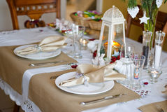 Christmas table. In white and gold colors Stock Photos