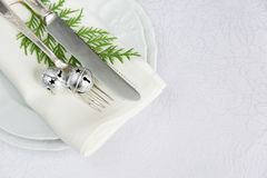 Christmas Table With Jingles And Green Twig Royalty Free Stock Photos
