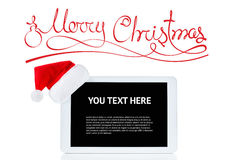 Christmas tablet computer with Santa hat, isolated over white background Stock Image