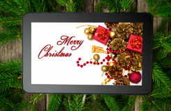 Christmas tablet on tree brunch Royalty Free Stock Images