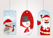 Christmas tag label. With snowman, bird and santa claus Royalty Free Stock Photo
