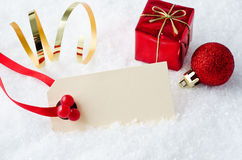 Christmas Tag in Snow with Ornaments Royalty Free Stock Photo