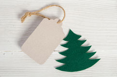 Christmas tag on wooden background Stock Photo