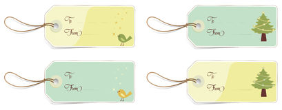 Christmas tags. 4 labels with Christmas illustrations. To and From included, so you can fill them with your own text Royalty Free Stock Photo