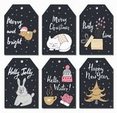 Christmas tags set with cute bird, cat, gift, bunny, hat, mittens, cup and tree. Hand drawn style. Vector illustration. Stock Image