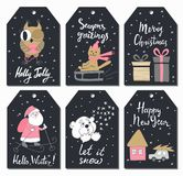 Christmas tags set with cute owl, cat sledding, gifts, Santa Claus, teddy bear, house, and car. Hand drawn style. Vector illustrat Stock Images