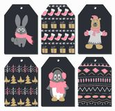 Christmas tags set with cute rabbit, bear, penguin. Hand drawn style. Vector illustration. Royalty Free Stock Photo