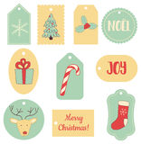 Christmas tags. Vector set of Christmas gift tags with images of deer, socks, gift, snowflake, sugar cane etc Royalty Free Stock Image