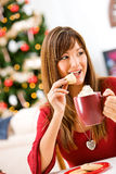 Christmas: Taking a Bite of Christmas Cookie Stock Photography