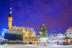 Christmas in Tallinn. Town Hall Square with Christmas Fair.Inscription on the signs in Estonian, Russian, Finnish: hot currant mu royalty free stock images