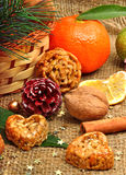 Christmas tangerines with dried lemon, walnuts, pine cones and b Stock Photo