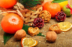 Christmas tangerines with dried lemon, walnuts, pinecone and bri Royalty Free Stock Images