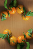Christmas. Tangerines with leaves on the table Stock Photos