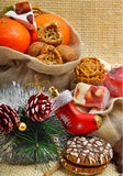 Christmas tangerines, lokum, pinecone and brittle candies on chr Stock Photography