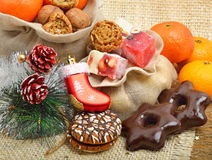 Christmas tangerines, lokum, pinecone and brittle candies on chr Stock Photo