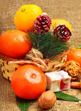 Christmas tangerines with sweet delights, walnuts, pinecone and Stock Photos
