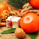 Christmas tangerines with sweet delights, walnuts, pinecone and Royalty Free Stock Photography