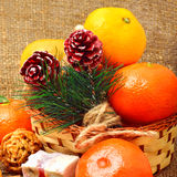 Christmas tangerines with sweet delights, walnuts, pinecone and Royalty Free Stock Photos