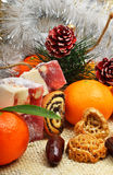 Christmas tangerines, turkish sweet; lokum, pinecone and brittle Royalty Free Stock Photography