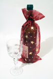 Christmas tasting. Christmas decorated bottle of wine with glass on white background Royalty Free Stock Photo