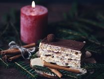 Christmas tasty cake on dark wooden background with spruce decoration. Royalty Free Stock Photography