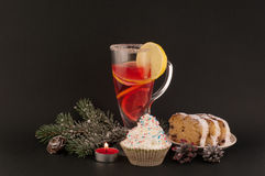 Christmas tea. цshtolen and christmas dekoraziya with tea on black background stock images