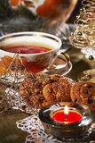 Christmas tea. With cookies in candlelight Royalty Free Stock Photos