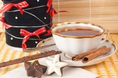 Christmas tea with cinnamon and cakes Royalty Free Stock Photo